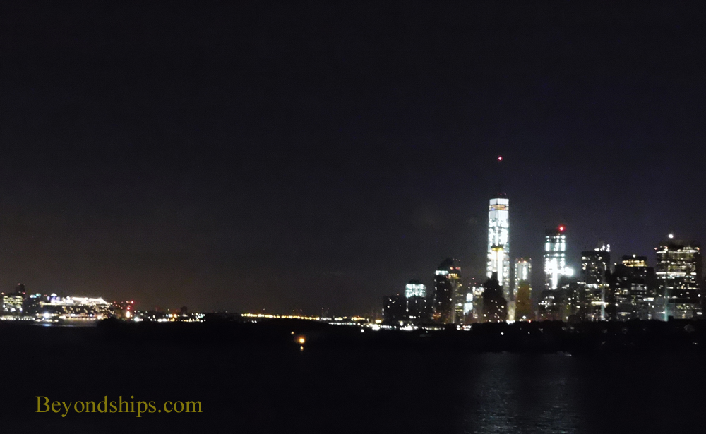 Norwegian Breakaway cruise ship with Manhattan skyline at night