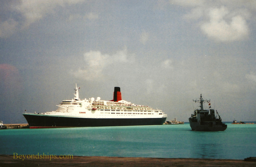 Warship and QE2, Queen Elizabeth 2, ocean liner, in Barbados