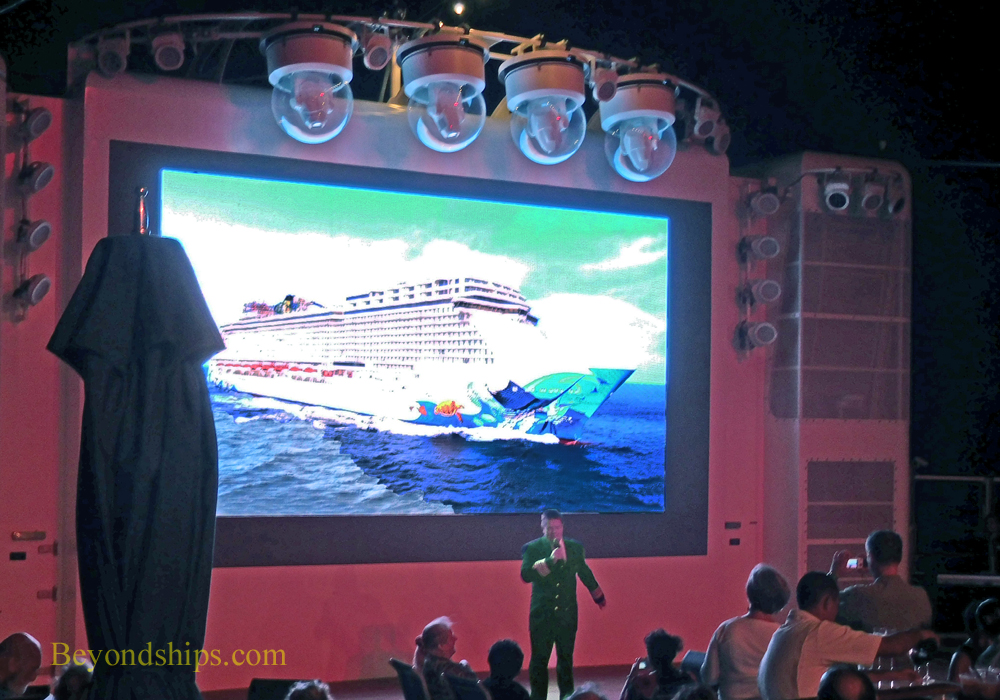 Captain addressing reception on Norwegian Escape cruise ship