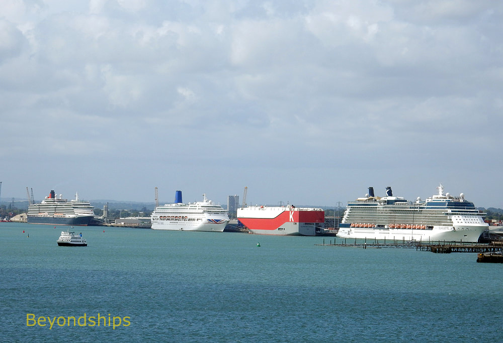 Cruise ships Queen Victoria, Oriana, and Celebrity Silhouette with a cargo ship.